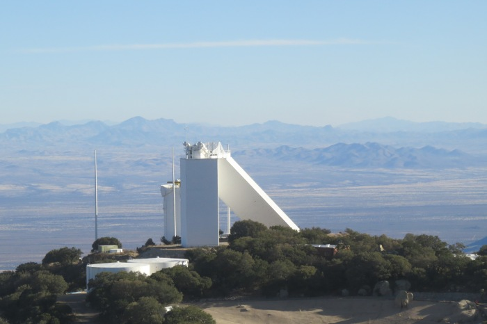 Arriving at Kitt Peak and walking to the Visitor's Center, guests have a clear sight of the McMath-Pierce telescope in the distance. This solar telescope lies on the southeast section of Kitt Peak. The McMath-Pierce is the largest solar instrument in the world with its primary function being the study of the sun.