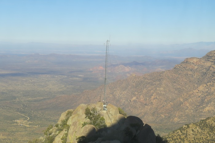 This photo is taken of the Sonoran Desert from the Scenic Viewing Gallery inside the Mayall. The Scenic Gallery provides a 360 degree view of Kitt Peak and the surrounding area. There is a 2000 acre no construction buffer zone in every direction around Kitt Peak. This is to ensure minimum light pollution for better astronomical observing.