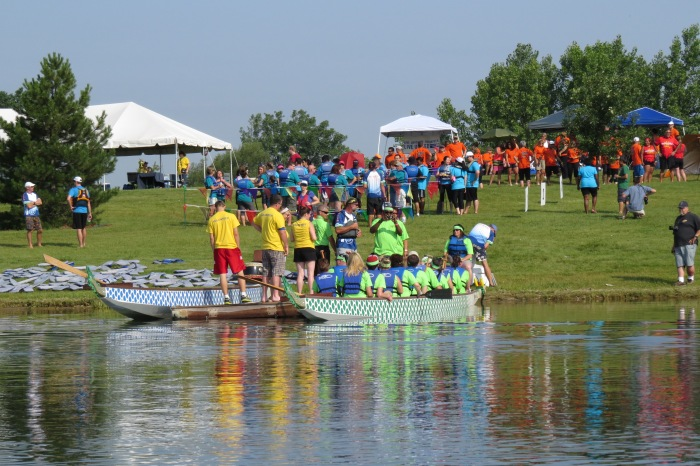 """""""The Lighthouse Lizards"""" (lime green) doing their final boarding while teams wait in the marshalling area."""
