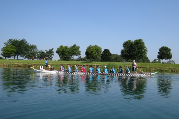 """""""The Power Paddlers"""" are making their way to the starting line for the first round of heats."""
