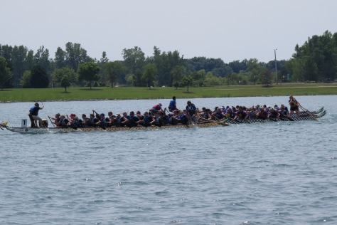 Three teams in a tight race utilizing every ounce of energy for the final push towards the finish line.